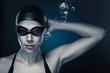 swimmer in dark blue light