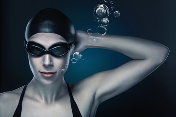 swimmer in dark blue light