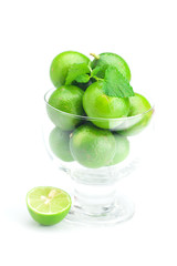lime in a glass cup and mint isolated on white