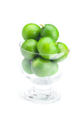 lime in a glass bowl isolated on white