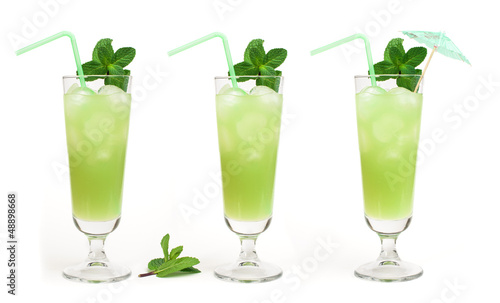 Green cocktail with cubes ice