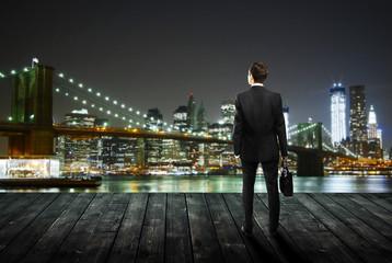 man standing on pier