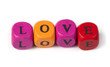 Word love on multicolored wooden cubes
