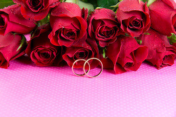 Wedding concept with roses and wedding rings