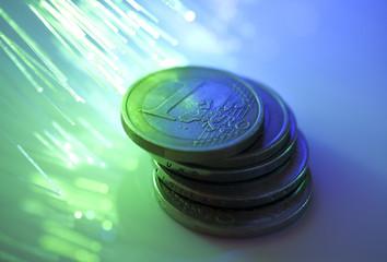 Euro coins on fiber optics background