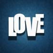Love concept - paper letters on textile