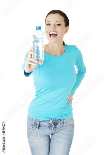 Woman with bottle of mineral water,