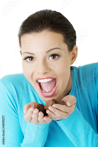 Woman with hand full of chocolates