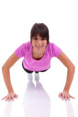 Young beautiful caucasian fitness woman doing push up exercises
