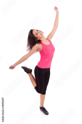 Young beautiful caucasian  fitness woman dancing