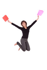 Happy caucasian woman jumping with shopping bags