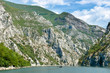 Small Boat And Steep Cliffs Of Koman-Fierza Lake, Albania