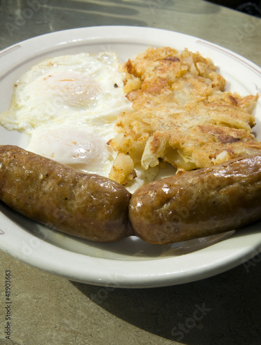 fried eggs over easy pork sausages home fried potatoes breakfast