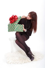Young woman opens Her christmas present