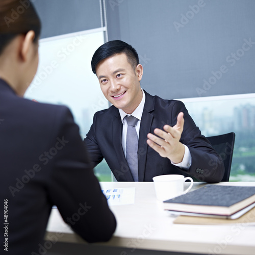 asian business people talking in office