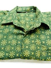 Green batik shirt isolated on white background from Yogyakarta,