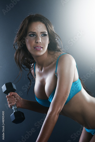 Athletic sexy young lady doing workout