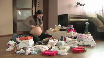 pregnant woman massaging her huge pregnant stomach