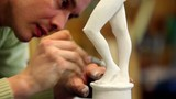Sculptor corrects malleolus of figurine by special tool