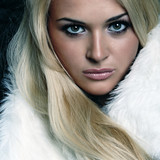 Beautiful blonde woman in a fur