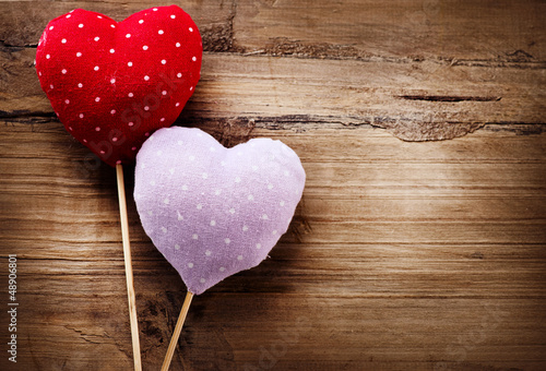 Valentines Vintage Handmade Hearts over Wooden Background