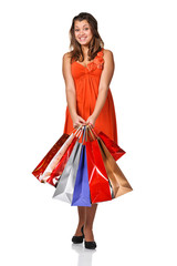 Beautiful woman with shopping bags. Isolated