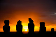 Several moai at Tahai on Easter Island during sunset