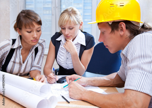 team of engineers working on construction project