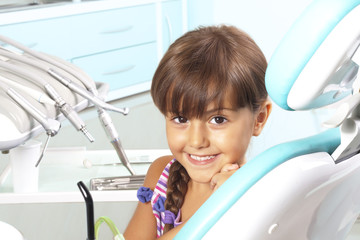 pretty little girl in the dentist chair