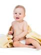 Adorable happy baby boy in towel