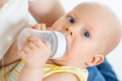 adorable baby drinking from bottle