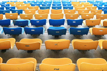 blue  and yellow seat rows in stedium