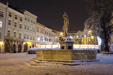 An open-air ice rink and old buildings in the center of Lvov