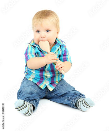 Little boy with wooden spoon, isolated on white