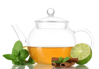 Teapot with mint,cinnamon and lime isolated on white