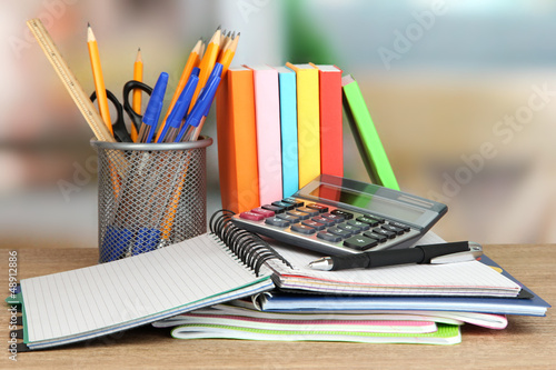 School supplies and books on wooden table