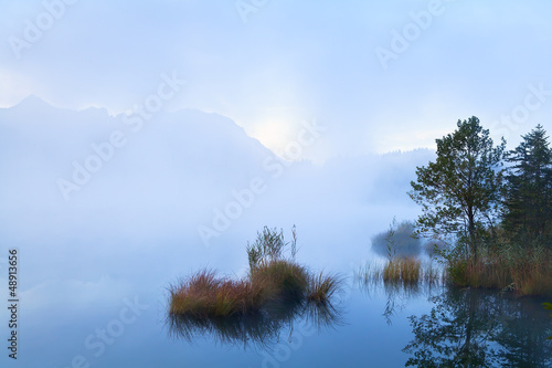 misty morning on alpine lake