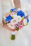Fototapety Bride with bouquet, closeup