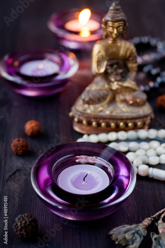 Buddha Statue and Candle
