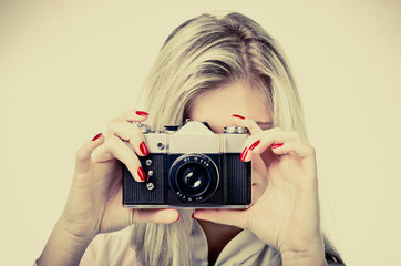 woman with old camera