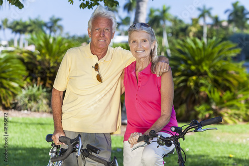 Happy Senior Couple on Bicycles In Park