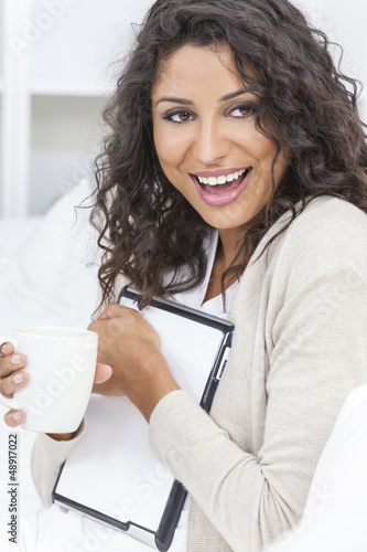 Woman Laughing Tablet Computer Drinking Coffee