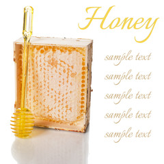 Honey in a wooden frame with a spoon
