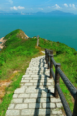 Hiking path surrounded by the sea