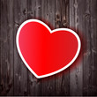 sweet red heart on wooden background