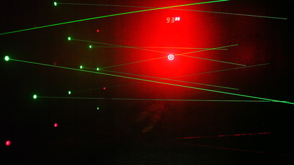 boy passes obstacles in form of laser beams on amusement ride