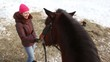 Woman feed horse
