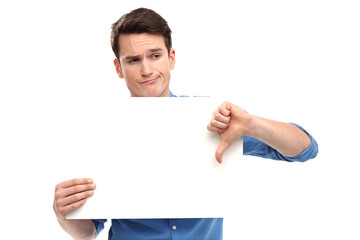 Man showing thumbs down with blank board