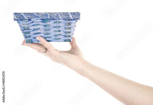 Hand is holding blue basket