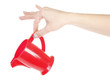 Red plastic kettle pitcher in hand